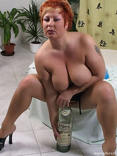 Big titted mature slut playing with toys and fire