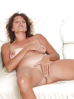 Tanned granny Josephine dips her finger in her pussy and licks her juices off her fingers