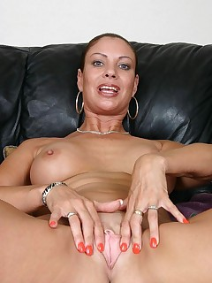 Hot GILF Vanessa Videl showing off her big tits and ass and spreading her thigh to examine her wet slit