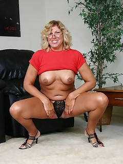 GILF pornstar Alicia playing with her boobs and raises her legs to show off her coot