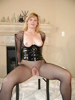 Smooth blonde momma in see-thru BDSM suit lustfully dildo fucking