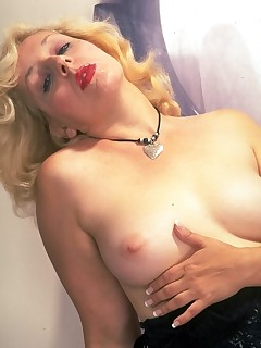 Blonde granny showing off tits