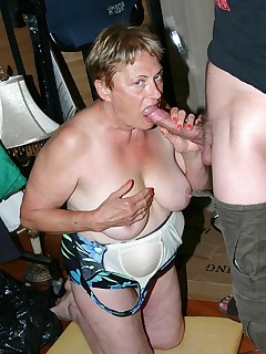 Plump grandma Ginger Spice spreading her cunt lips while slobbering a meaty cock