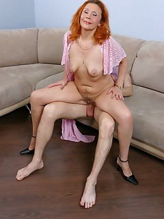45 y.o. redhead enjoys some anal cock riding and squats down to suck her younger lovers cock