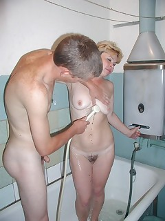 Blonde granny enjoying a pussy pounding in the shower