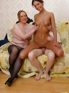 Mature fatty in stockings and swarthy teen babe share guy's cock during threesome drill