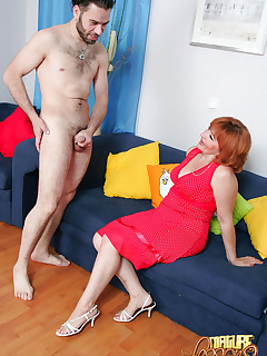 Mature redhead and nubile slut team up to ride big cock and take it ass to mouth