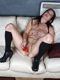 Naughty brunette mom playing with a dildo