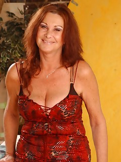 Mature redhead chick licking her huge hooters