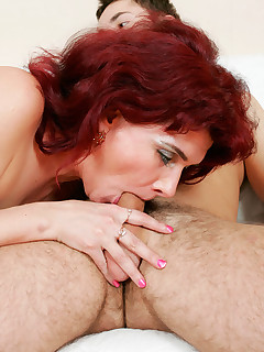 Red-haired 40+ woman and her younger boyfriend get naked to enjoy oral and anal sex