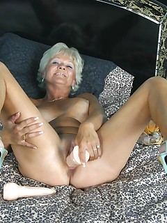 Tanned granny Marcial is spreading wide to show off her hot pussy in the bedroom