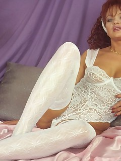 Redhead MILF posing seductively in her lacy white stockings!