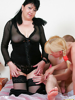 Sexy blonde slut and her plump mature teacher suck dick, get cunt-fucked and share a cumshot