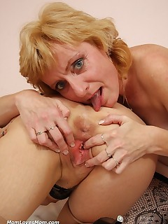 Mature lesbo muff licking and fake cock hump
