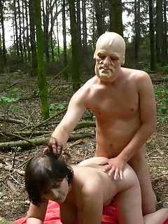 Chunky mature fucked by a masked man in the woods