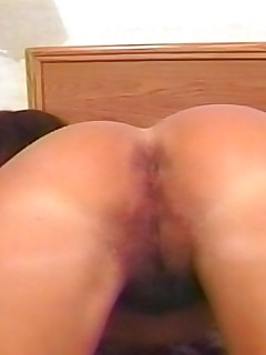Pretty brunette milf with a big hairy bush gobbles a stiff cock then gets penetrated
