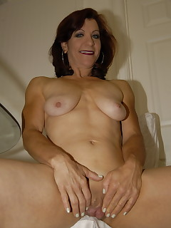 This horny mama gets fucked by a hard fist and a toy
