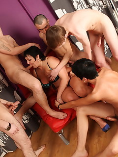 Five young cocks to keep a big-tittied mature brunette busy