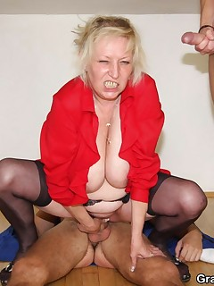 Naughty grandma eats one dick and lets the other fuck her old pussy and she takes it all