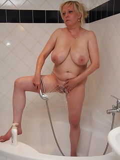 The old slut showers to get clean and he fucks her pussy like she would die without it