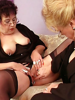 Two sexy grannies rubbed each others' horny twats before going down on each other