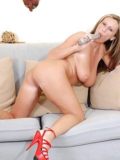 Desirable milf cougar pandora forcefully fucks her tight mature pussy with a glass dildo while wearing red stillettos