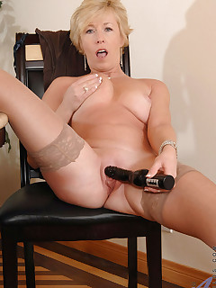 Hot tempting blonde Chanel torments her cougar snatch with a huge black vibrator