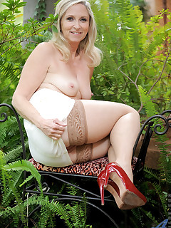 Naughty Anilos Annabelle Brady fingers her needy mature pussy outdoors