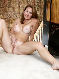 Hot mama Crystal teases us by showing off her fuck hole with her legs spread wide