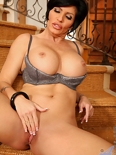 Fabulous cougar Shay Fox displays her gigantic tits on the stairs