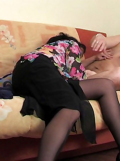 Sex-crazy mature gal in barely black pantyhose mastering her fucking skills