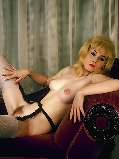 Blonde retro babe from the seventies in amazing sexy outfit