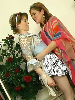 Lesbian mature babe in black pantyhose getting to heated lick-n-kiss action