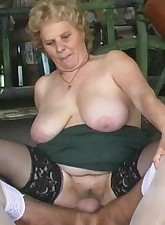 Plump granny fucked in a barn by a guy in nylons