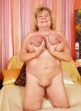 Big titty granny plays with her titties and her pussy for her younger lover