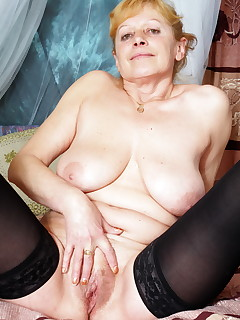 Granny spreads her pussy for a big dildo and some cock