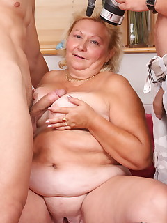 Blonde granny has a threesome with two studs
