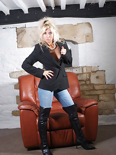 Tight blue jeans and some big leather boots in this naughty shoot