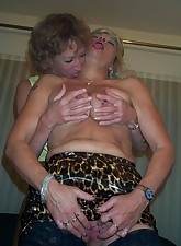 Two horny mature lesbians at play on the bed