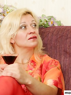 MILF firstly takes glass of wine and her young boyfriends dick right after that