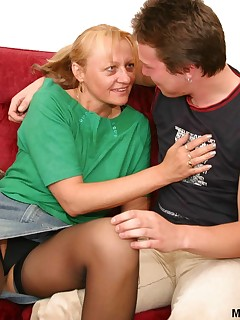 Younger guy fucks funny granny in black stockings