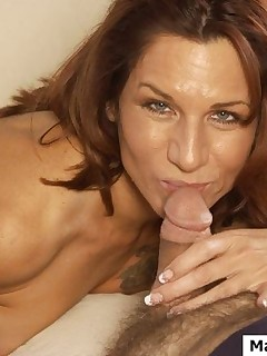 MILF just came into the room and unzipped the guys fly and the next moment his tool disappeared deep in her throat