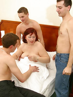 Voluptuous MILF gets fucked by 3 fellows