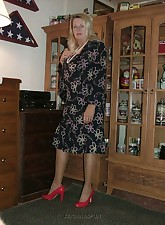 All dressed up  silk dress red pumps stockings and garters  getting ready to take it all off