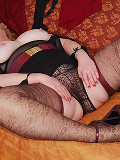 I sure like the lacy design on these brown stockings plus the dark red tops complement  my little skirt To complete my outfit a see through black blouse with..