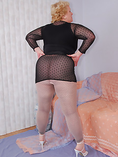 How do you like my sexy black fishnet leggings to do something different I wear sheer pantyhose on top at first To complete my outfit a tarty black lace slip..