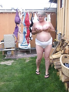 A nice spring day and the Girdle Goddess is doing some laundry Watch as i spread out a bunch of my sexy brasAnd spread it all for you