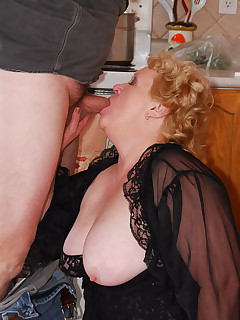 I am busy doing my kitchen chores when I feel a hard cock poking at my butt Thats what I get for wearing sexy sheer black lingerie when doing the housework..