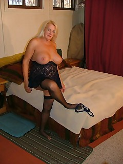 MILF  sexy in lingerie and stockings  see how the stocking ends up on the inside