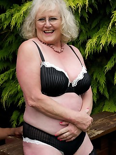 Hi Guys heres another small set of Pics of me in my garden wearing Black Underwear but I soon Strip off so I can Work on my all over Tan and look out for the..